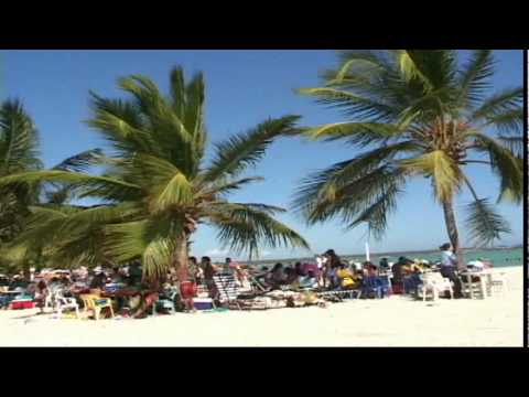 Playa Boca Chica Beach - A typical weekend day on Playa Boca Chica Beach in the Dominican Republic. Just 45 minutes from the capital of Santo Domingo, tourists and locals alike head ...