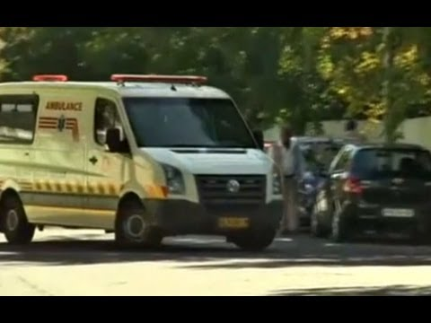 Nelson Mandela arrives home in ambulance after hospital discharge
