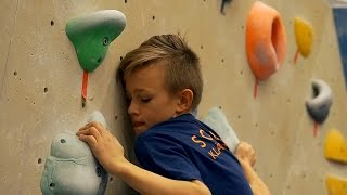 Gabriel Is Fighting On A Reachy Problem by Eric Karlsson Bouldering