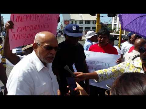 Former President Donald Ramotar joins picketing Wales Estate workers outside Parliament