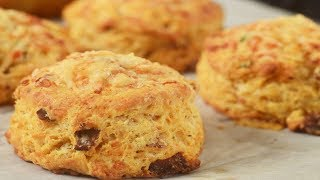 Recipe here: http://www.joyofbaking.com/breakfast/BaconAndCheeseScones.html Stephanie Jaworski of Joyofbaking.com demonstrates how to make Bacon and Cheese Scones. This savory scone is packed with bits of bacon, cheese, and chives. It is delicious on its own or cut in half and spread with butter. Makes a great accompaniment to soups and stews. Sometimes I use this scone to make a Breakfast Biscuit. Just cut the scone in half and fill it with a fried egg. You can also add a slice of tomato, a slice of avocado, and/or some lettuce.New Recipes every Thursday before noon Eastern time. Join our Facebook Page: http://www.facebook.com/joyofbaking