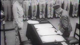 Newsreel of Japanese signing formal instruments of surrender aboard USS Missouri