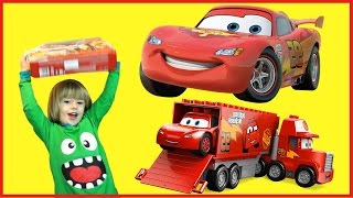 Disney Pixar Lightning McQueen 100+ cars toys GIANT MONSTER TRUCK OPENING Kids Video