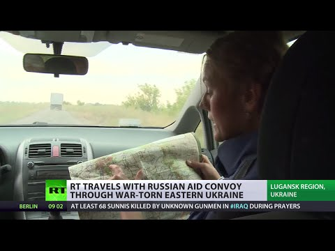 RT travels with Russian aid convoy through war-torn E. Ukraine