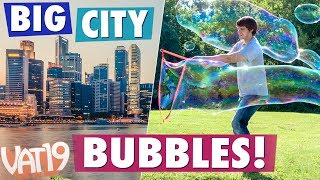 "We took the Bubble Thing Giant Bubble Maker around town and surprised some pedestrians!Buy here: https://www.vat19.com/item/bubble-thing-giant-bubble-maker?adid=youtubeSubscribe to Vat19: http://www.youtube.com/subscription_center?add_user=vat19com******************Early Squad Giveaway!Click here to enter: https://gleam.io/rmLqY/early-squad-bubble-thingThis is just our way of saying ""Thanks!"" to our mega fans. ****************** Follow Vat19:Facebook: https://facebook.com/vat19Instagram: https://instagram.com/vat19/Twitter: https://twitter.com/vat19SnapChat: https://www.snapchat.com/add/vat19teamShop hundreds more curiously awesome products:https://www.vat19.com/?adid=youtubeCreate spectacularly large bubbles with Bubble Thing. This amazing ""thing"" allows you to easily make bubbles up to 35 feet in length!Start by dipping the Bubble Thing's fabric loop into your specially formulated mix. Then lift it up, pull back on the slider to open the loop, and swing the thing through the air. For more fun, spin in place and completely surround yourself with an enormous bubble.Each Bubble Thing Kit includes a wand (with 90-inch fabric loop) and a bottle of Big Bubble Mix (makes 2.7 gallons). Refills of Big Bubble Mix (makes 5.4 gallons) are also available separately. Watch More Vat19:Latest Uploads: https://www.youtube.com/user/vat19com/videos?shelf_id=1&view=0&sort=ddPopular Videos: https://www.youtube.com/user/vat19com/videos?shelf_id=7&view=0&sort=pThe Sample Room: https://www.youtube.com/watch?v=jL1JK0U6s28&list=PLSqiExuEA-RG_aF5u4q5gEvJiUfoa6l25Fun Stuff to Eat: https://www.youtube.com/watch?v=7RXmNRr8x7I&list=PLSqiExuEA-REt5gzR0A9ernZNHlZ2glIlAbout Vat19:Vat19 is dedicated to ""curiously awesome"" gifts, candy, toys, gummy, putty, puzzles, games, and more! In addition to making funny commercials you'll actually want to watch, we produce amazing challenge videos, document our outrageous contraptions, and invite you to a front row seat for our silly stunts. Sometimes we blow things up, fill up a bathtub or pool with crazy stuff, dare each other to eat super spicy foods, and answer ""burning questions"" from our viewers."