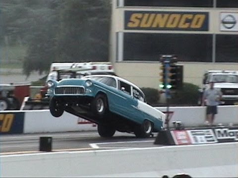 Get an oil pan view of this '55 Chevy at the drag strip