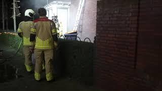 Schade aan woning bij containerbrand