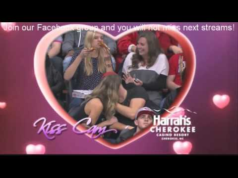 Kiss cam girl devours her true love