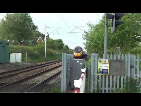 Pendolino at 125Mph Through Level Crossing