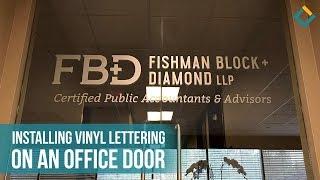 Installation Process of Vinyl Lettering on a Glass Door