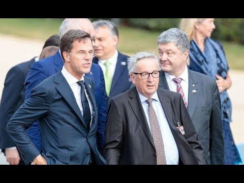 Джеан-Клааде Джанккер стоккбесоффен анд еине Шанде беи НАТО Гипфел 12.Джали 2018