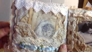 This is my fabric and lace journal. Lots of layers of lace. And trim, book pages, music paper and doilies. Two hidden pockets hold two small journals for mak...
