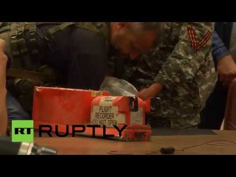 flight - The Ukrainian militia have handed over to Malaysian experts the black boxes from the Malaysian Boeing-777 airliner that crashed in east Ukraine on July 17. READ MORE: http://on.rt.com/y023f2...