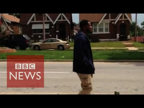 shooting - Police in St Louis released a video of their officers shooting a robbery suspect as he held a knife, but their pledge of transparency has lead to more questions. Subscribe to BBC News HERE...