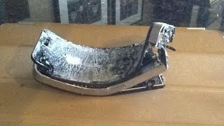 HD Brand new iphone 5 destruction explodes breaks blows up in the wall