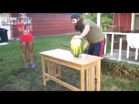 Guy cuts hands instead of watermelon