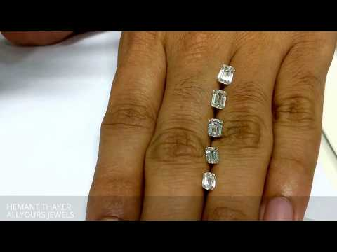 Emerald cut diamond size comparison on hand 0.90 - 0.40ct