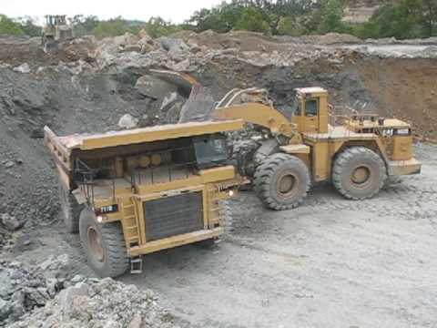 Video Loading a Haul Truck with Overburden download in MP3, 3GP, MP4, WEBM, AVI, FLV January 2017