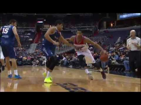 Otto Porter dribbles behind his...