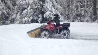 8. 2001 Polaris 500HO with Moose County plow