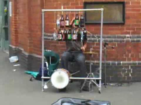 Inspector Gadget theme played on bottles on the street
