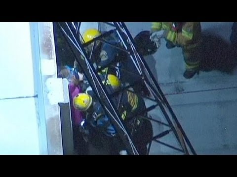 Trapped woman rescued from gap between buildings in California - no comment