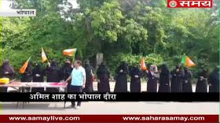 Muslim women standing with BJP flags for welcome of BJP President Amit Shah in Bhopal...