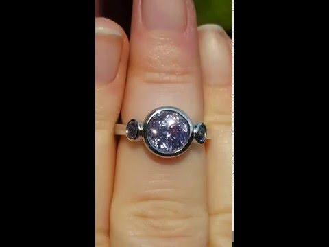 Violet sapphire and  alexandrite bezel platinum egagement ring