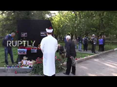 Graduation quotes - Russia: Kerch residents pay tribute to college attack victims