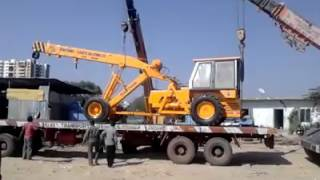 crane being loaded on trailer