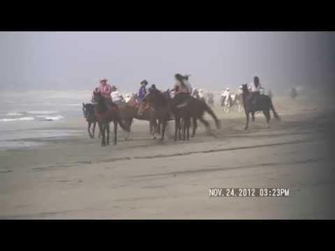 HORSEBACK RIDERS INVADE THE BEACH