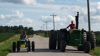 Fun video of a John Deere 6030 and a converted John Deere 110 garden tractor made to look like a 6030 out for a Sunday cruise ...