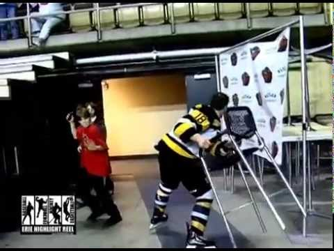 Hockey Player Fights then Smashes His Helmet and Throws a Chair
