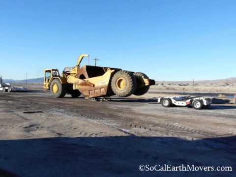 COZAD jeep & dolly CAT 651B unload