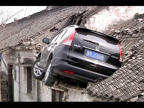 SUV Crashes into House Roof
