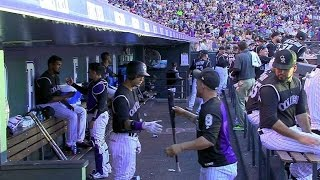 Gerardo Parra warms up Carlos Gonzalez's bat before he hits a home run in the bottom of the 4th inning Check out...