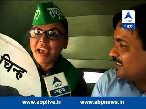 Rakhi Sawant campaigns with woman auto driver 21 April 2014 11 AM