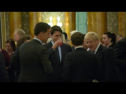 Watch Trudeau, Macron and Johnson appear to gossip about Donald Trump on hot mic