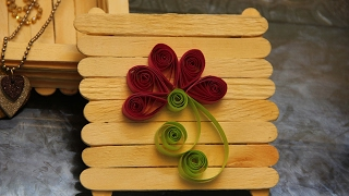 If  you or your kids are bored of day to day routine and are in search for something new to get out of this boredom then  there is nothing great than art and craft activity. In this video we are going to show you in a detailed manner one craft idea that you or your kid can build in a hassle-free manner. In this video a 15-year-old girl is creating this craft work. Requirements for this work are:  ice cream sticks, glue stick, scissor, marker or pen and paper ribbons to design some flowers for décor. Just follow the steps shown in this video and your work of art will be ready within a few minutes. So, enjoy watching…