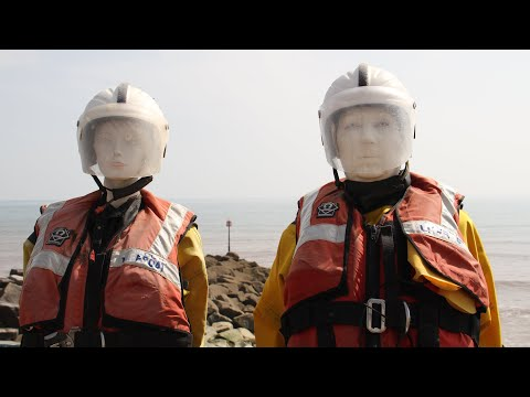 mannequin-man performming as a Living Mannequin: Famous in Sidmouth, Sid the mannequin stands outside in all weathers, with his partner Alma, collecting donations for the Sidmouth lifeboat. Over the Easter weekend, Sid became real and thanked the locals and visitors for their generous donations. 