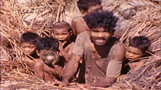 Link to order this clip: http://www.criticalpast.com/video/65675077521_natives_children-in-foxhole_native-women_world-War-II Historic Stock Footage Archival ...