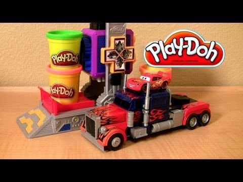 transformers - This is called play doh Transformers Autobot workshop play set from Dark of the Moon. Roll cars into the workshop and watch as they transform into robots! This playset comes with 4 cans, 4...