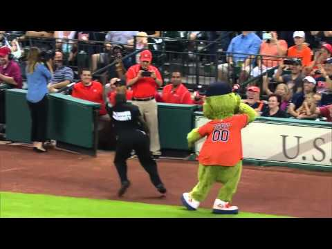 orbit, houston astro's mascot clash a security guard...