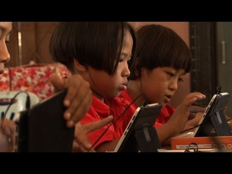 Computer - Thailand aims to provide 13 million students with free tablet computers by the end of next year but critics say this won't help increase the levels of educat...