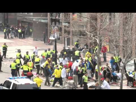 blast - (Boston Globe) Graphic footage. Early scenes of the afternath of blast at the finish line of the Boston Marathon. By David Abel/Globe Staff.