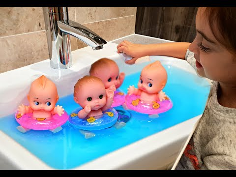 Baby Dolls Swimming in the Sink