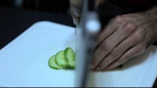 Cutting cucumber with a Macbook Air