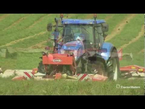 T7060 - new holland t7060 operating a kuhn mower.