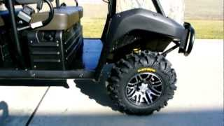 9. 2013 Kawasaki Mule 4010 Trans Camo with Lift Kit, ITP SS316 Wheels and more!