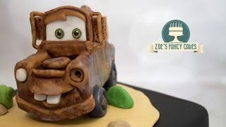 How to make Mater the rusty truck from Disney Pixar's Cars movie as a cake topper. With the upcoming release of the new Cars 3 film I decided Mater would be a great cake topper to make! :)You can also see my older tutorial on how to Lightning Mcqueen as a cake topper here - https://youtu.be/ElL0TyFwhG4Tools and products used in this video - Laped modelling paste - https://tinyurl.com/zl6shysCake modelling tool - https://www.facebook.com/commerce/products/1878762348816211/Craft mat - http://amzn.to/2dMKpl9Balling tool - http://amzn.to/1ZQfKTzCircle plunger cutter - http://amzn.to/1OdVB3iMore circle cutters - http://amzn.to/29bKnn4Extra white sugarflair - http://tinyurl.com/nu6u7yxChocolate rainbow dust - http://amzn.to/2oTc7A5To see more of my cakes and creations please visit my pages below-Facebook https://www.facebook.com/zoesfancycakes Twitter https://twitter.com/zoesfancycakesInstagram https://instagram.com/zoesfancycakes/Website http://www.zoesfancycakes.co.uk/You can also check out my online courses with 25% off below! :)Faces - https://www.udemy.com/how-to-make-sugar-craft-faces/?couponCode=YT25OFFRoses - https://www.udemy.com/how-to-make-sugar-craft-roses/?couponCode=YT25OFF